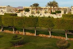 Picturesque morning view of tropical luxury hotel resort building with palm trees and bushes. Sharm El Sheikh, Egypt. Famous touristic place and travel royalty free stock image