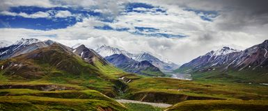 Mountains in Alaska. Picturesque Mountains of Alaska in summer. Snow covered massifs, glaciers and rocky peaks royalty free stock photo