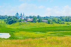 The picturesque nature of Suzdal. The wide wetland, named Ilinskiy meadow opens the view on Suzdal panorama with onion domes of Orthodox churches and its Royalty Free Stock Photography