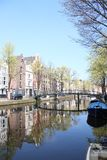 Picturesque neighborhood in the heart of amsterdam  with some amazing  reflections stock photography