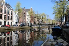 Picturesque neighborhood in the heart of amsterdam  with some amazing  reflections royalty free stock photography