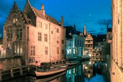 Picturesque night canal Dijver in Bruges. Scenic cityscape with the picturesque night medieval canal Dijver in Bruges, Belgium. Toning in cool tones Royalty Free Stock Photography