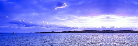 Blue and white colored cumulus cloud, sunset seascape. Picturesque non urban coastal , blue and white cloud, blue sky, sunset landscape. With mostly cumulus stock photos