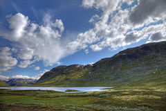 Picturesque norwegian landscape. With small lake and green hills, scandinavian Europe Royalty Free Stock Photo