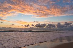 Picturesque ocean beach on sunrise, sunset Stock Image