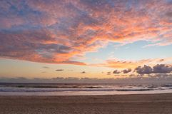 Picturesque ocean beach on sunrise, sunset Stock Images
