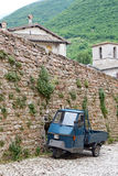 Picturesque old alley with dwellings and an ancient italian vehicle Ape Piaggio Stock Images