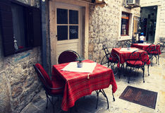 Picturesque old cafe in Budva. MONTENEGRO. BUDVA - JUNE 18, 2017: Picturesque old cafe in the historical center of the city. Budva is one of the most beautiful Stock Photos