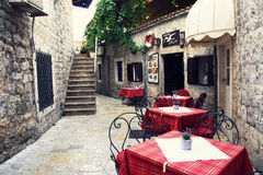 Picturesque old cafe in Budva. MONTENEGRO. BUDVA - JUNE 18, 2017: Picturesque old cafe in the historical center of the city. Budva is one of the most beautiful Royalty Free Stock Photo