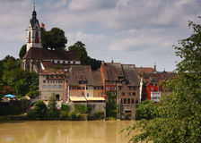 Picturesque old German town. Colourful old German houses upon brown river in summer Stock Photos