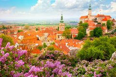 Old Historic European Town with castle, clock and flowers stock photos