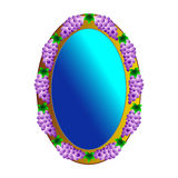 Picturesque oval wall mirror with grapes. Mirror frame decorated with cut-out bunch of grapes Royalty Free Stock Photography