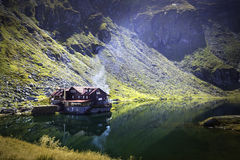 A picturesque overview of glacial Balea Lake in the Fagaras mountain region of Romania. Royalty Free Stock Photo