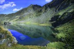 A picturesque overview of glacial Balea Lake in the Fagaras mountain region of Romania. Stock Photo