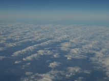 Picturesque panorama of blue sky and cloud as seen through window of an aircraft above Europe Stock Photos