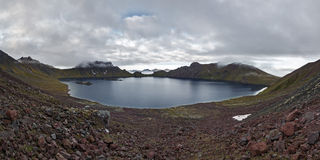 Picturesque panorama: view of crater lake active Khangar Volcano. Kamchatka, Russia Stock Images
