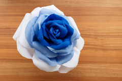 Picturesque paper rose. Origami. Giant multicolored flower. Stock Photo