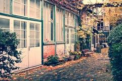 Picturesque parisian alley in autumn, Paris France. Picturesque parisian alley in autumn, Paris, France royalty free stock image