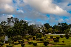 Picturesque park with evaporation from natural active geysers at stock images