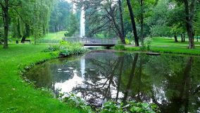 Picturesque park at Jasna Gora Monastery, Czestochowa, Poland. Visit the idyllic Stanislaw Staszic Park with tiny lake and beautiful fountain among the lush stock video footage