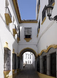 Picturesque passage in Andalusian town Stock Images