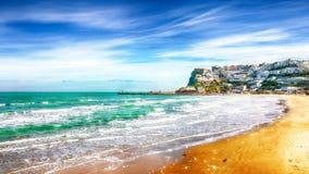Picturesque Peschici with wide sandy beach in Puglia, adriatic coast of Italy. Location Peschici, Gargano peninsula, Apulia, southern Italy, Europe royalty free stock photo
