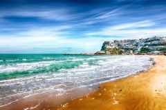 Picturesque Peschici with wide sandy beach in Puglia, adriatic coast of Italy. Location Peschici, Gargano peninsula, Apulia, southern Italy, Europe royalty free stock images