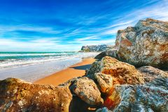 Picturesque Peschici with wide sandy beach in Puglia, adriatic coast of Italy. Location Peschici, Gargano peninsula, Apulia, southern Italy, Europe royalty free stock photos
