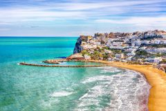 Picturesque Peschici with wide sandy beach in Puglia, adriatic coast of Italy. Location Peschici, Gargano peninsula, Apulia, southern Italy, Europe stock photo