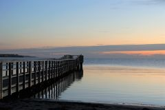 Picturesque pier at the sea, burial at sea stock photography