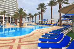 The picturesque pool and a  high-rise hotel Stock Photography