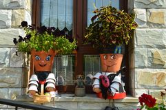 Picturesque Pots Decorated As Two Young Asturian Musicians In Taramundi, Asturias, Spain. Art, History, Travel. stock images