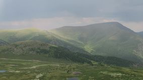 Picturesque rainbow in the mountains. Amazing mountains valley scenic view after the rain. Altai mountains. stock video