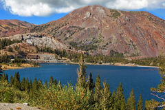 Picturesque  red mountain on coast of lake Royalty Free Stock Image