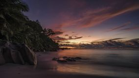 Picturesque red sky after sunset on paradise Beach on the seyche. Beautiful romantic red sky after the sunset on paradise beach on the seychelles with granite Stock Photography