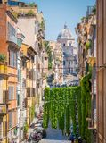 The picturesque Rione Monti in Rome, with the Basilica of Santa Maria Maggiore in the background. stock images