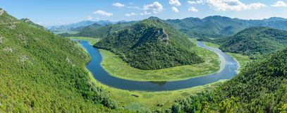 The picturesque river flows among mountains stock photos