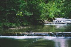 Picturesque river in forest Stock Photos