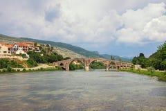 Picturesque river landscape with old stone bridge. Bosnia and Herzegovina, Trebinje, view of Trebisnjica river and Perovic Bridge. Picturesque river landscape stock images
