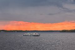 The picturesque river landscape at sunset. The Volga river, Samara city, Russia. River pleasure boat.  Royalty Free Stock Photo