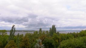 The picturesque river landscape. The Volga River. Embankment in the city of Samara, Russia. Summer or autumn windy day stock video