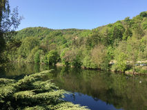 Picturesque river valley on a bright cloudless summer day Stock Photos