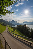 Picturesque road along an alpine lake Royalty Free Stock Images