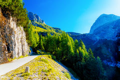 Picturesque road in beautiful alpine landscape with big mountains and small villages Royalty Free Stock Photos