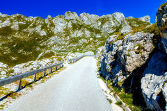 Picturesque road in beautiful alpine landscape with big mountains and small villages Stock Photo
