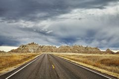 Picturesque Road In Badlands National Park With Stormy Sky.