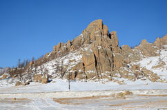 Picturesque rock in a snow-covered steppes Stock Photography
