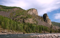 Picturesque rocks on the bank of the mountain river. Stock Image