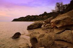 Picturesque rocky shore twilight Royalty Free Stock Images