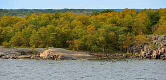 Picturesque rocky and green island in archipelago of Turku stock photos